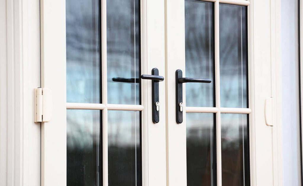 White uPVC french door and handles close up