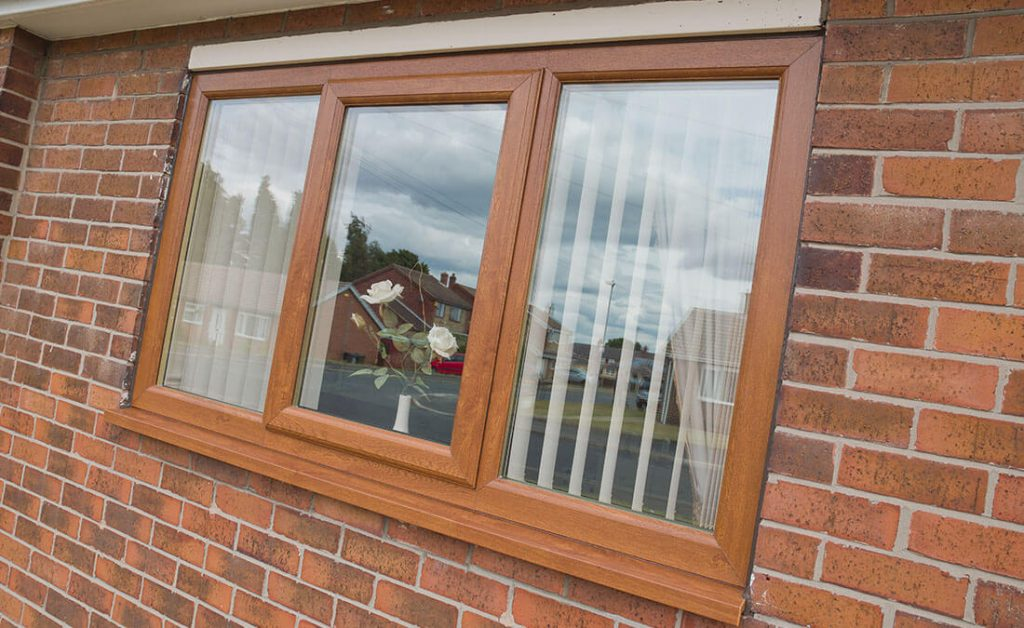 Golden oak effect uPVC casement window