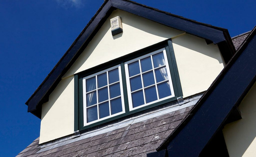 White uPVC tilt and turn windows with astragal bars