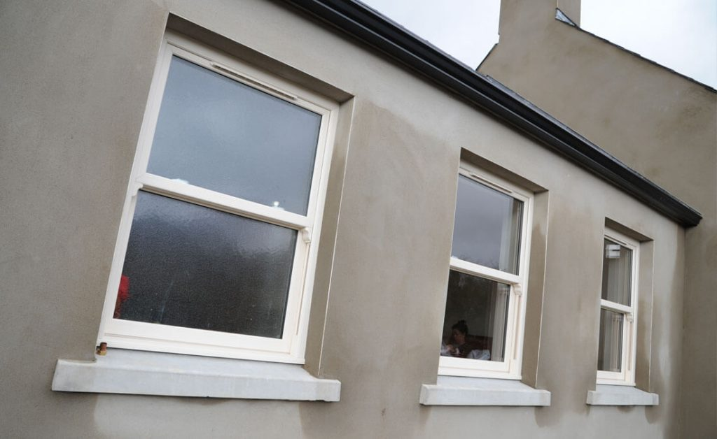 Cream uPVC vertical sliding windows