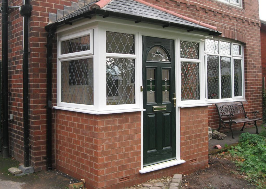 Green composite door and porch
