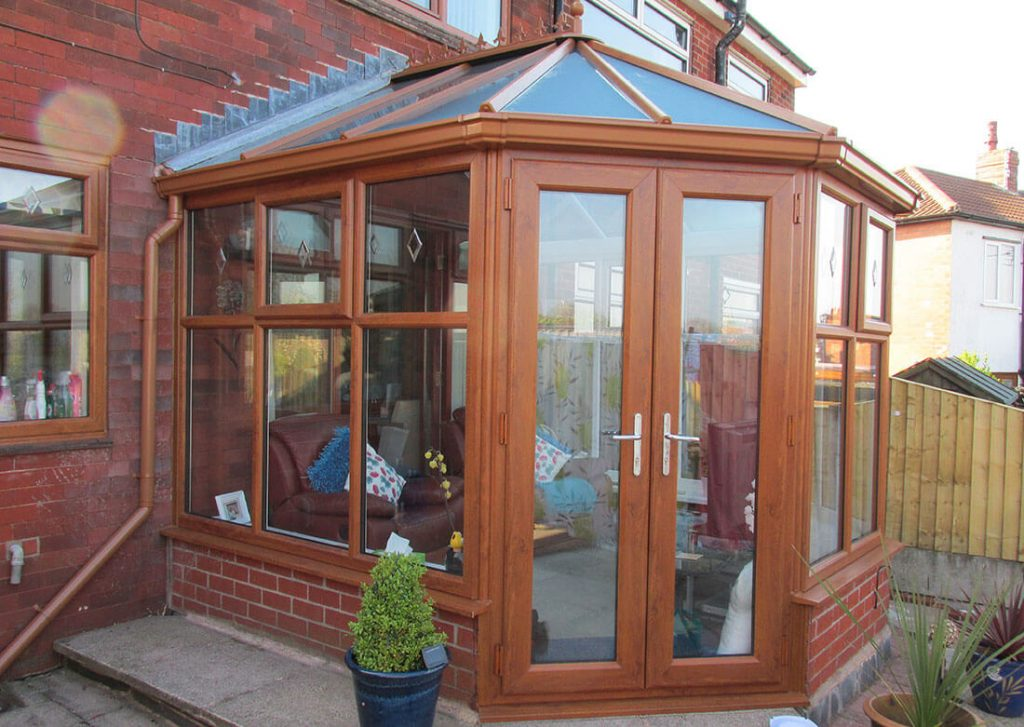 Golden oak effect uPVC Victorian conservatory